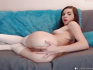 Young Teen is wearing stockings dancing and fingering her tight little ass