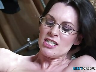 Busty babe in specs rides