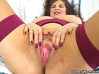Big boobed milf Lily May takes off her clothes and slides a dildo up her fine cunny (now available in Full HD 1080P). Bonus video: English mature Gilly.